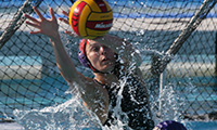 A Regals water polo player blocking the shot