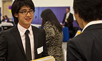 A student talking to employers at the career fair