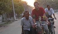 A study abroad student riding a bike in Myanmar